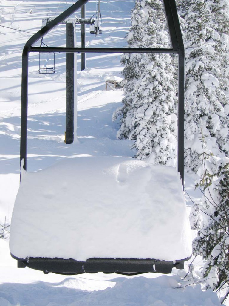 Silverton Mountain Chairlift chair covered in a half meter of snow